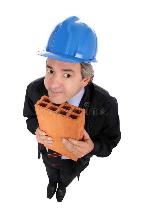 Contractor with hard hat and brick. Contractor holding a terracotta brick and wearing a blue hard hat isolated against a white background royalty free stock photography