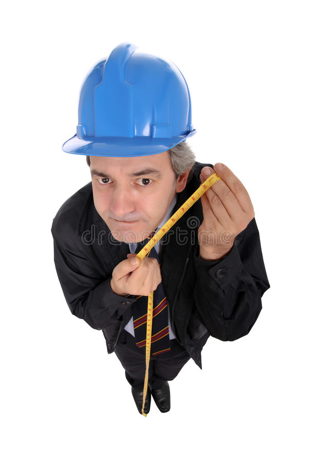 Contractor with hard hat and tape. Contractor holding a tape measure and wearing a blue hard hat isolated against a white background royalty free stock images