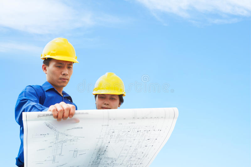Contractor holding building plan stock photography