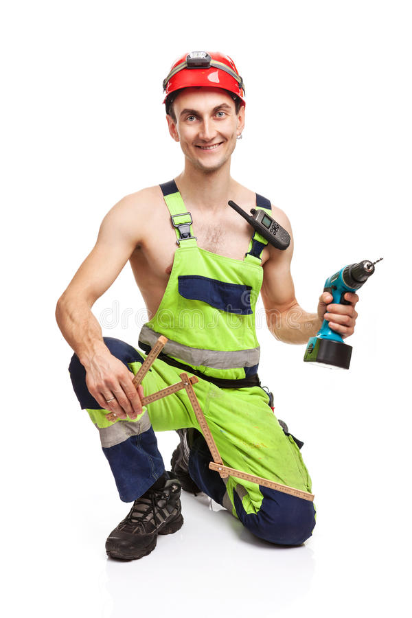 Contractor holding ruler and electric screwdriver stock image