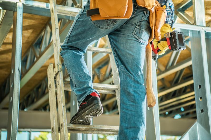 Contractor on a Ladder stock photo