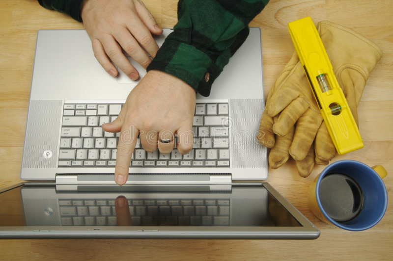 Contractor on Laptop royalty free stock photo