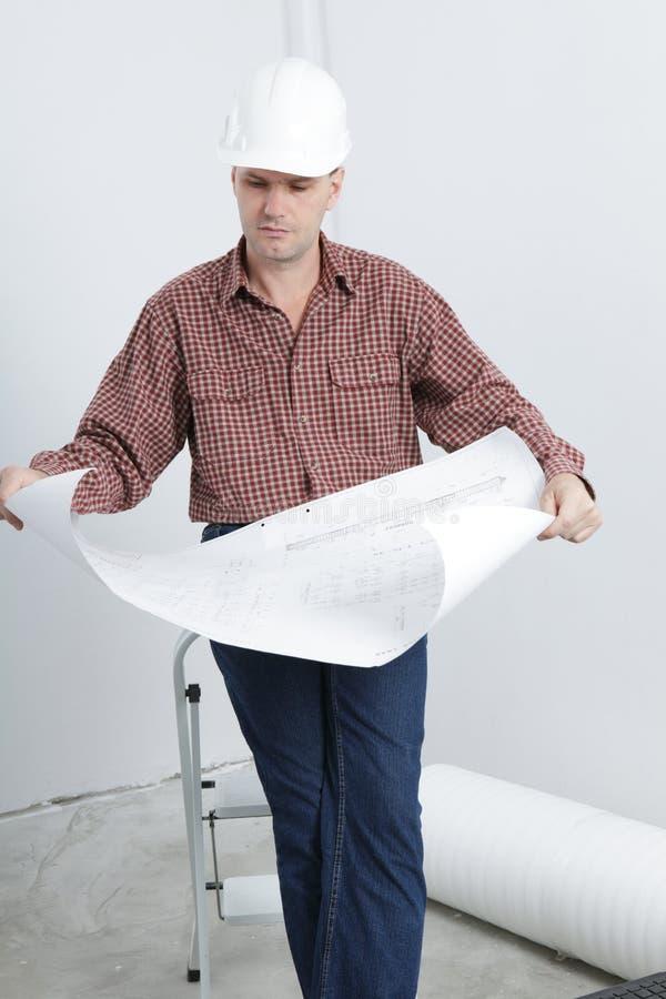 Download Contractor Looking Blueprints Stock Photo - Image: 10601764