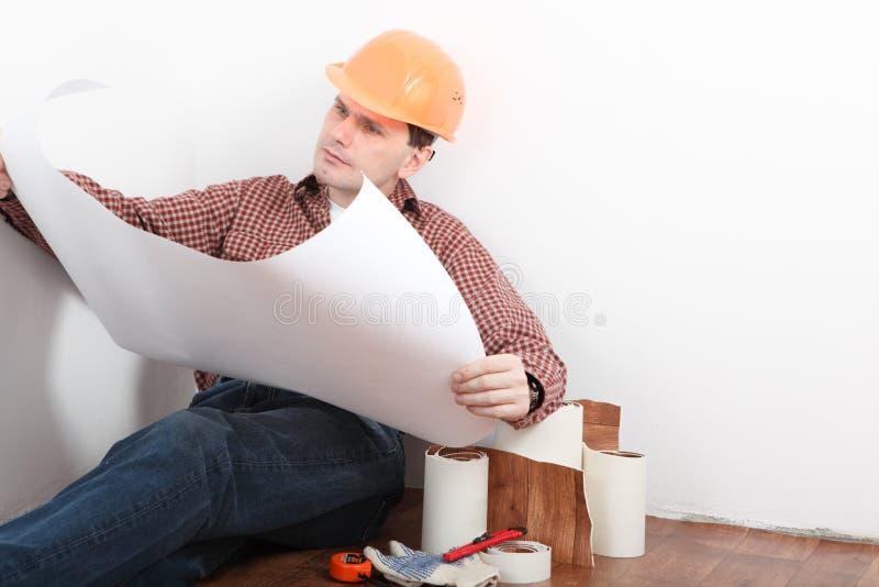 Contractor looking blueprints stock images