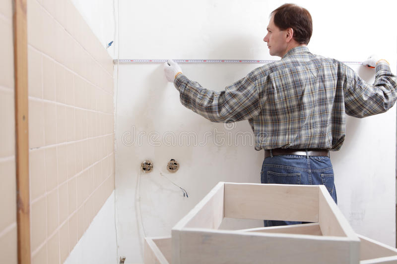 Download Contractor Measuring A Kitchen Stock Image - Image: 22102639