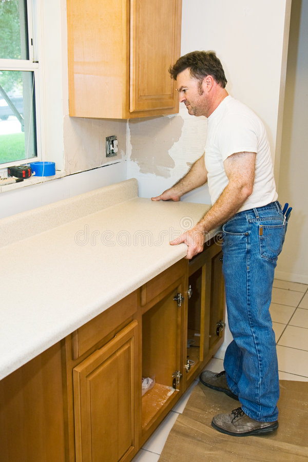 Download Contractor Remodeling Kitchen Royalty Free Stock Photography - Image: 6883537