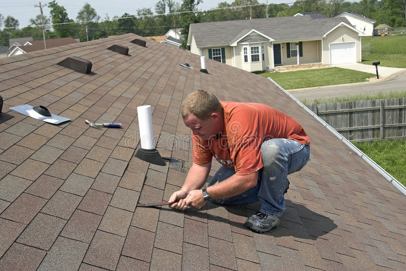 Contractor Repairing Roof stock images
