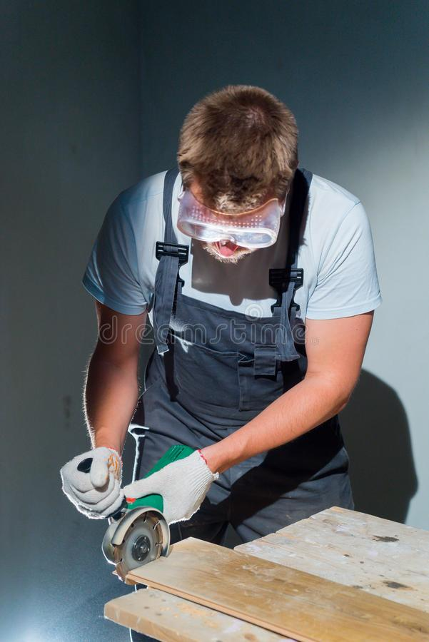 Contractor Using Circular Saw Cutting of New Laminate Flooring Renovation stock photography