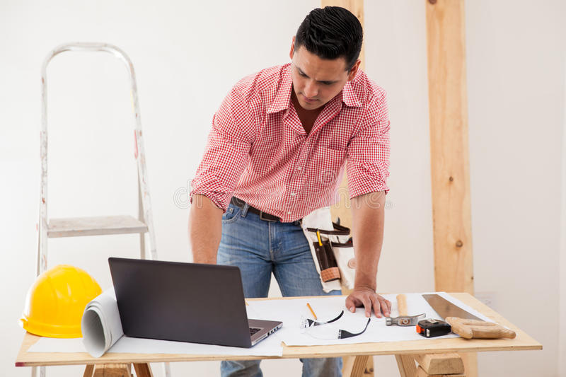 Contractor using a laptop at work royalty free stock photo