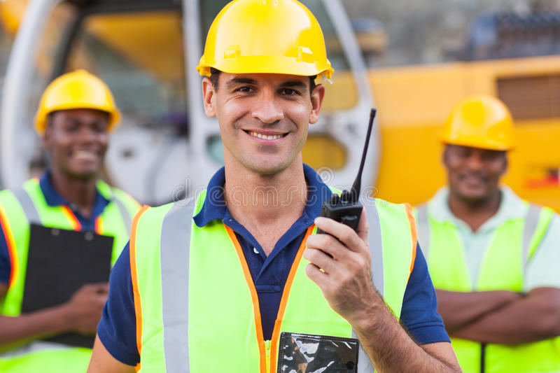 Contractor with walkie-talkie. Portrait of smiling contractor with walkie-talkie royalty free stock images
