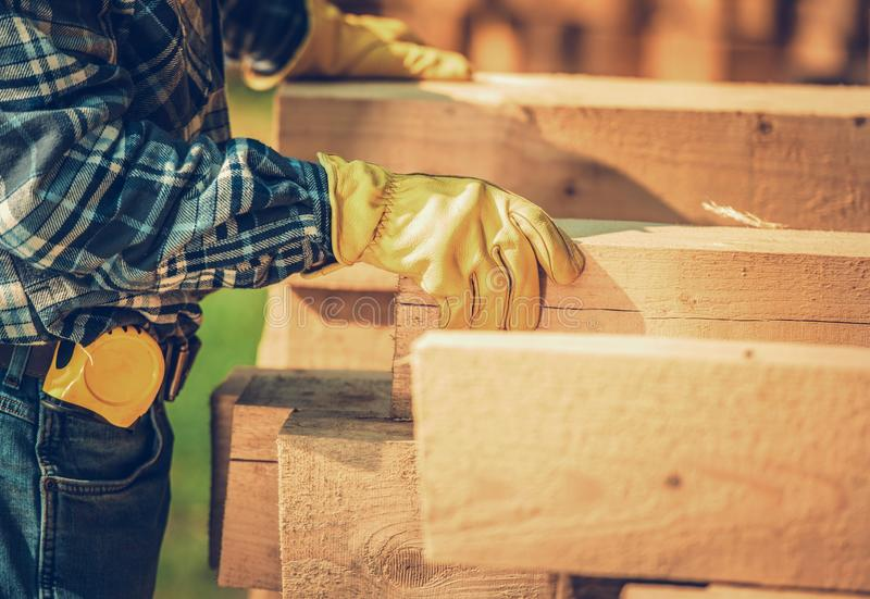 Contractor and Wood Beams royalty free stock photography