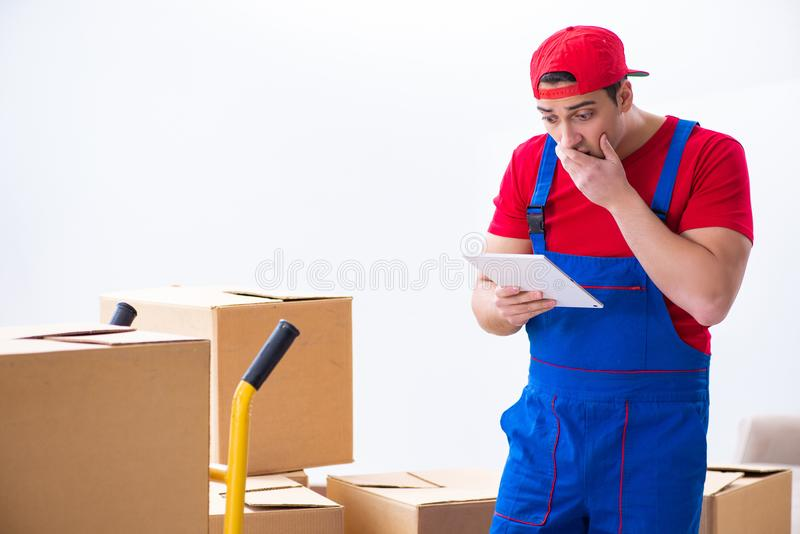 The contractor worker moving boxes during office move. Contractor worker moving boxes during office move stock photography