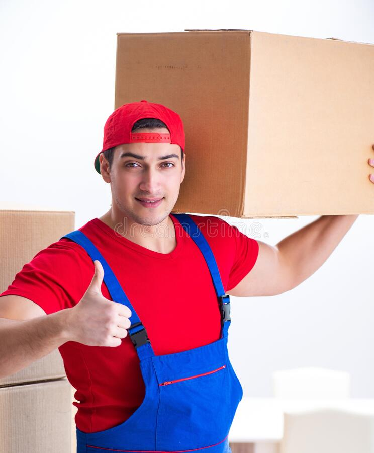 Contractor worker moving boxes during office move. The contractor worker moving boxes during office move stock photos