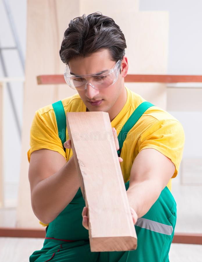 Contractor working on laminate wooden floor royalty free stock image