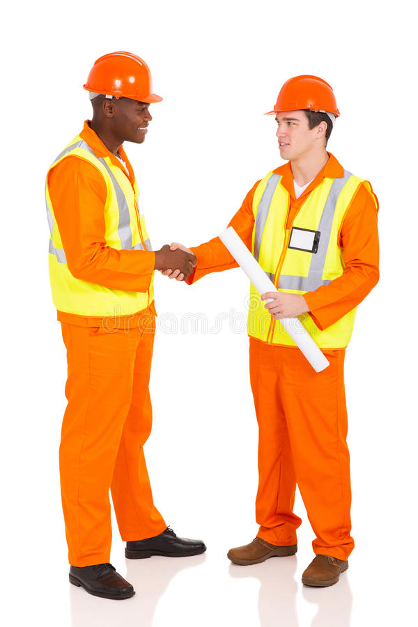 Contractors hand shaking. Friendly contractors hand shaking on white background royalty free stock image