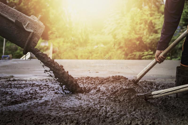 Contractors are pouring cement floors. In the evening royalty free stock image