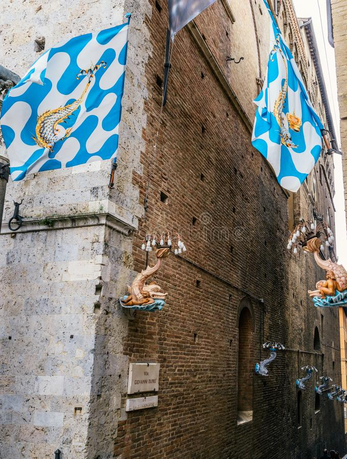 A contrada is a district, or a ward, within an Italian city of Siena. Siena, Italy - October 29th, 2017: A contrada is a district, or a ward, within an Italian stock photos