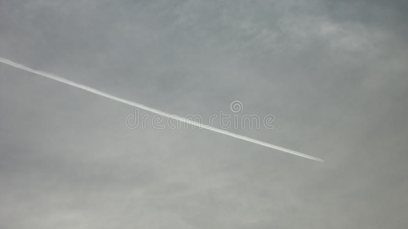 Contrail with cloudy sky. Evening sky in winter of japan. POI stock photo
