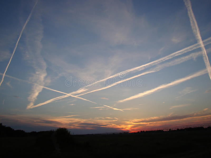 Contrail in the sky royalty free stock photo
