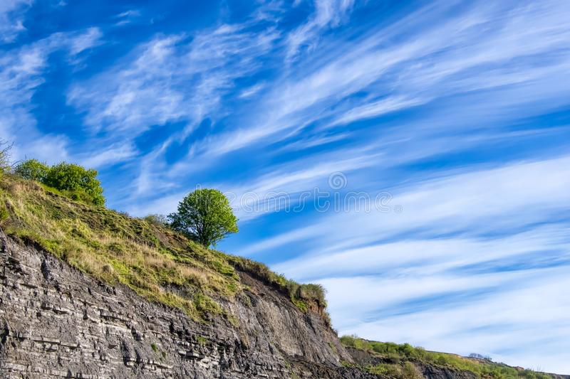 Contrails Over Black Ven - Lyme Regis. Black Ven is a cliff between Lyme Regis and nearby Charmouth. The area is part of the jurassic coastline and is popular royalty free stock photography