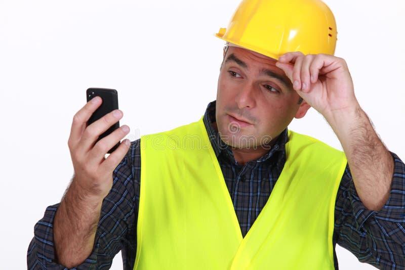 Contramestre com telefone imagem de stock