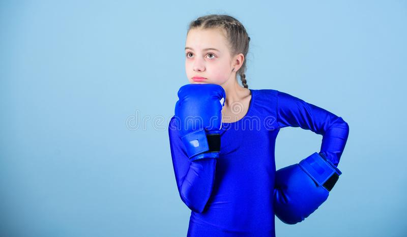 Contrary to stereotype. Boxer child in boxing gloves. Female boxer change attitudes within sport. Rise of women boxers. Contrary to stereotype. Boxer child in stock photos