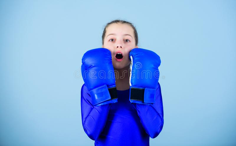 Contrary to stereotype. With great power comes great responsibility. Boxer child in boxing gloves. Female boxer change. Attitudes within sport. Rise of woman royalty free stock photography