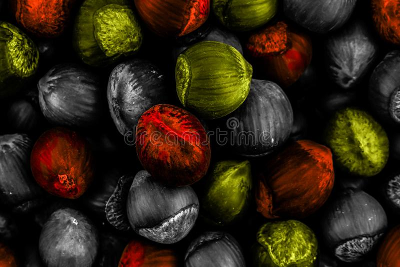 Contrast background abstract yellow red dark background a lot of hazelnuts close-up background design menu site stock image