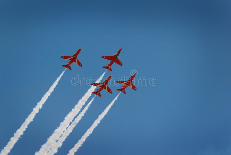 A contrast of colors. The red arrows display excellent teamwork royalty free stock photography