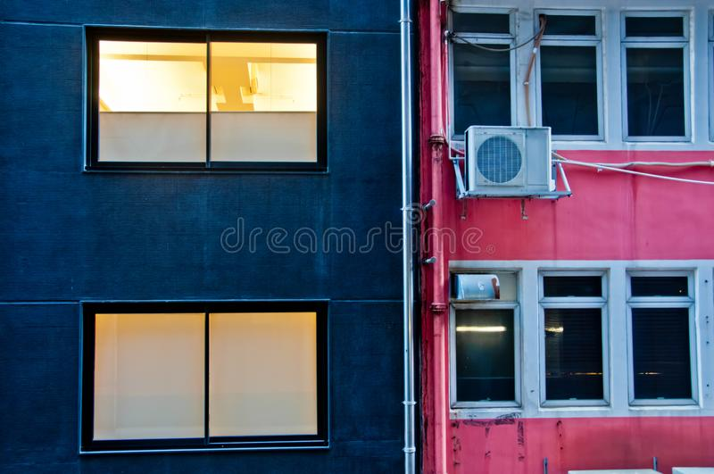Contrast colour scene of blue and pink building walls in Hong Kong China SAR in the evening.  stock photos