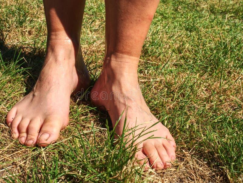 Contrast line on barefoot legs show socks  border, dusty skin. Contrast line on barefoot legs show socks  border, clear and dusty skin. Horrible smell sweaty royalty free stock photography