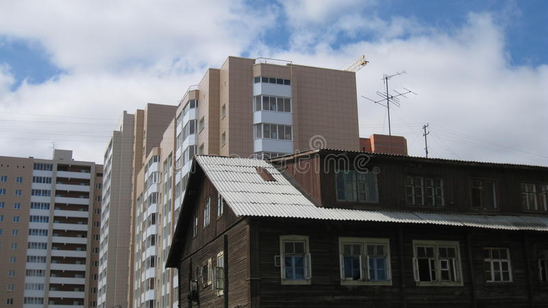Contrast old and new buildings, Russia Siberia. stock photo