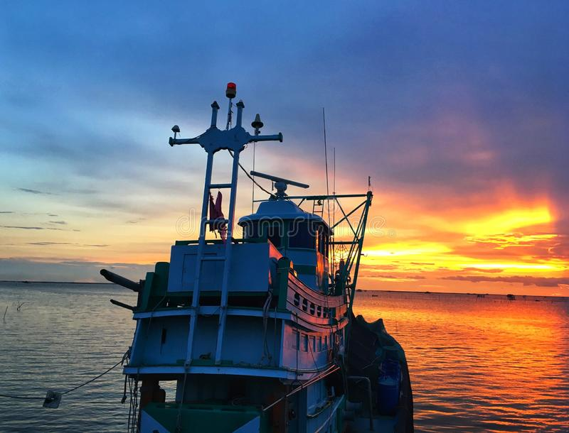Contrast of sky and sea between boat in evening. Composition of nature royalty free stock images