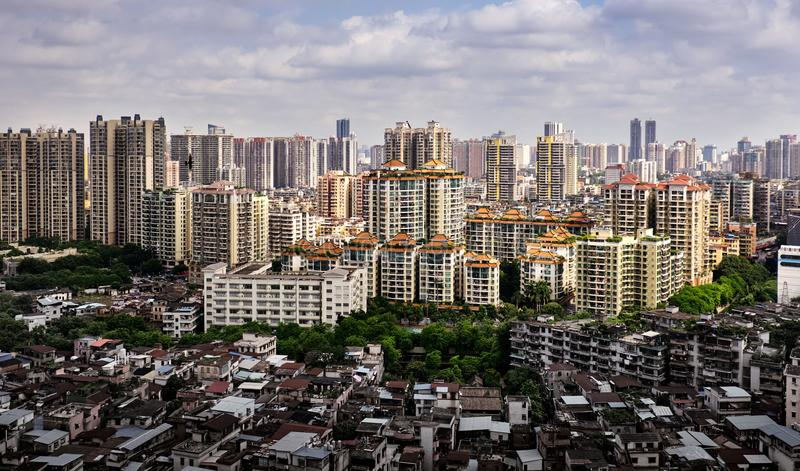 Contrast view of many high-end enterprises such as finance, insurance, real estate and Congestion, Guangzhou city, China. stock photo