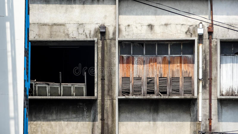 Contrast of Windows on an old Building. This photo was taken at an old building in Bangkok, Thailand stock image