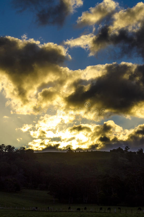 A contrasted clouds sunset scene royalty free stock photography