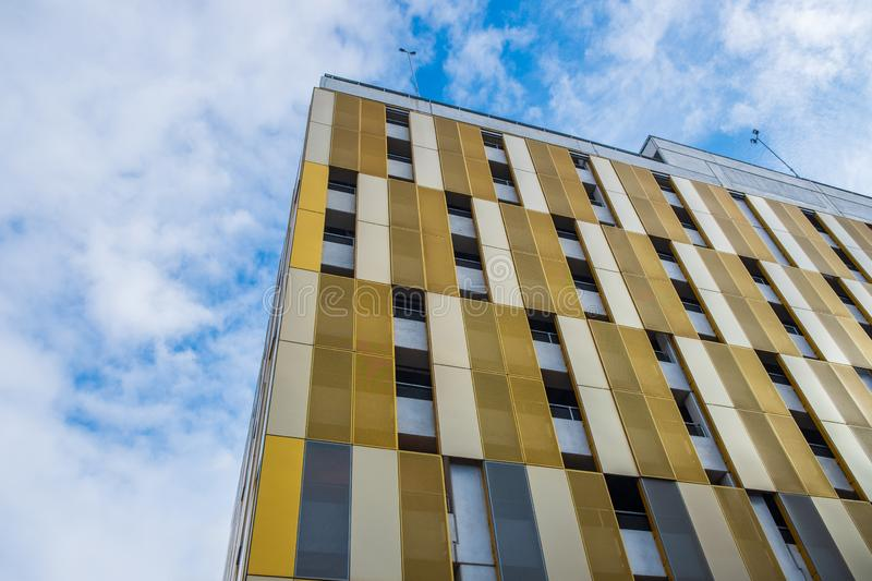 Contrasting colors and shapes on building facade against the sky. In the city center of Manchester, UK stock image