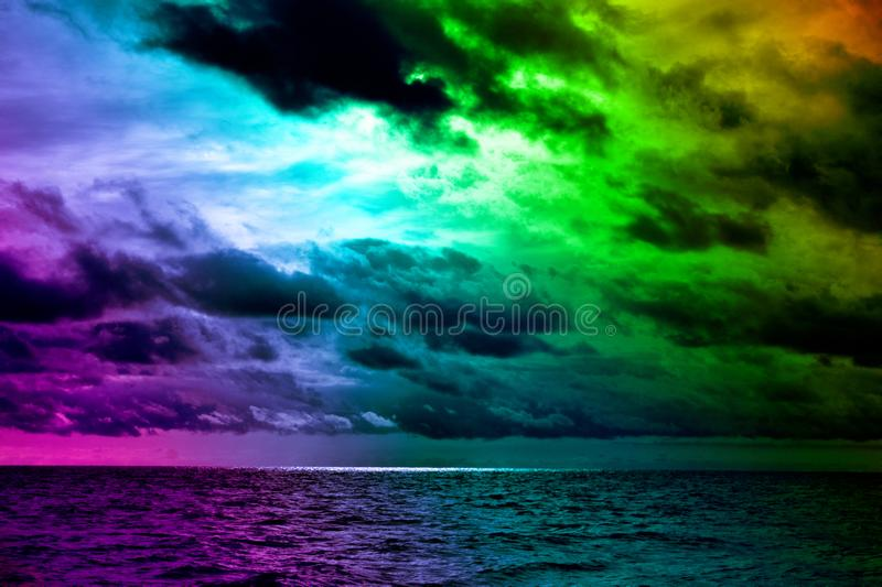 Contrasting colors of weather and sunset over the sea royalty free stock images