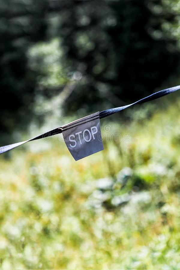 Contrasting light and dark side with stop sign. Inscription STOP royalty free stock photos