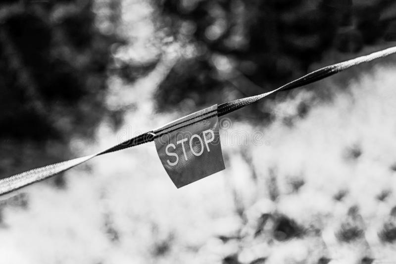 Contrasting light and dark side with stop sign. Inscription STOP. Black and white photo. Contrasting light and dark side with stop sign. Inscription STOP, black royalty free stock photography