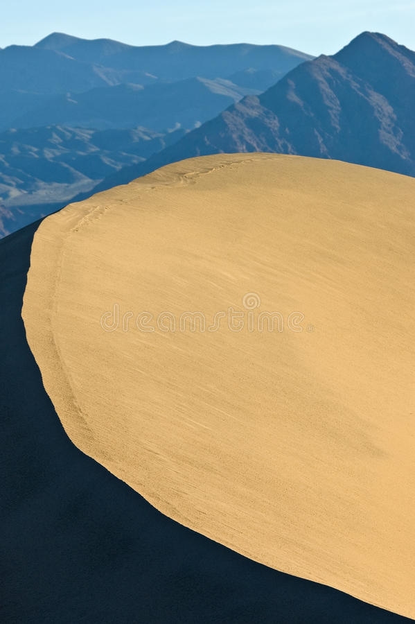 Download Contrasting Sand Dune Ridge And Mountains Stock Photo - Image: 14851518