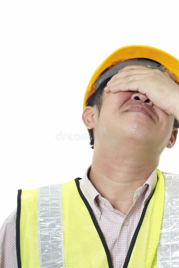 Contratante de construção asiático com pesar foto de stock royalty free