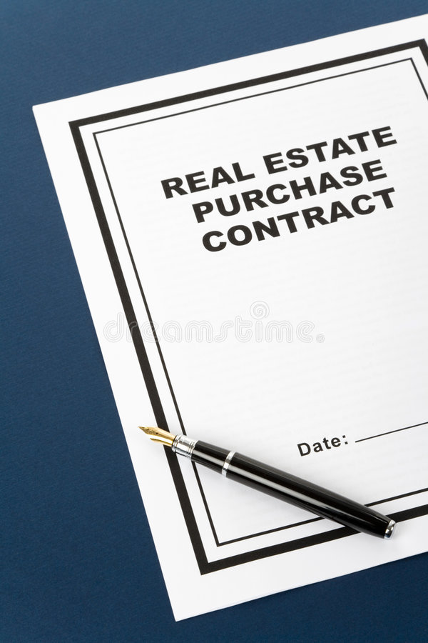 Contrato de compra de las propiedades inmobiliarias imagen de archivo