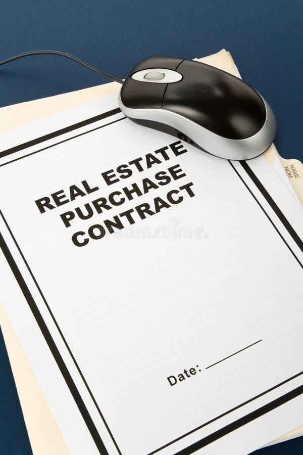 Contrato de compra de las propiedades inmobiliarias foto de archivo