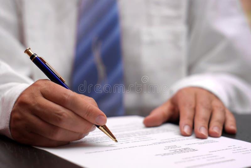 Contratto di firma fotografia stock