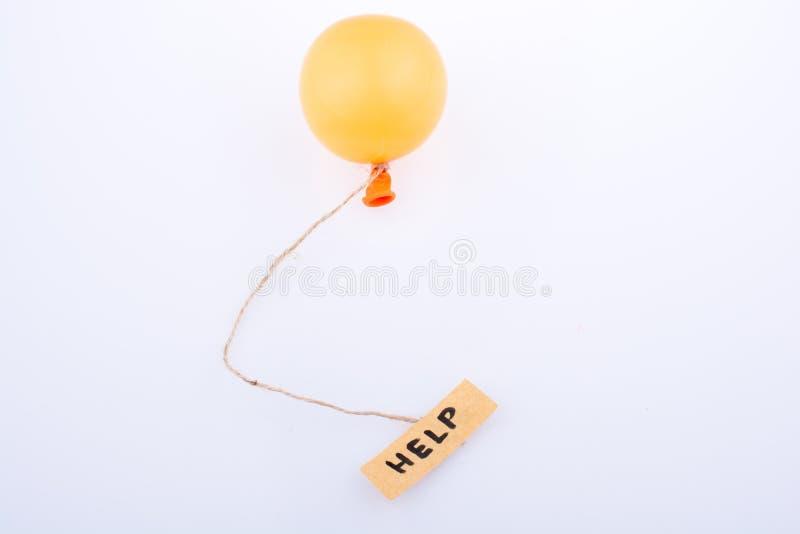 Contribuisca ad esprimere la carta scritta allegata ad un pallone fotografia stock