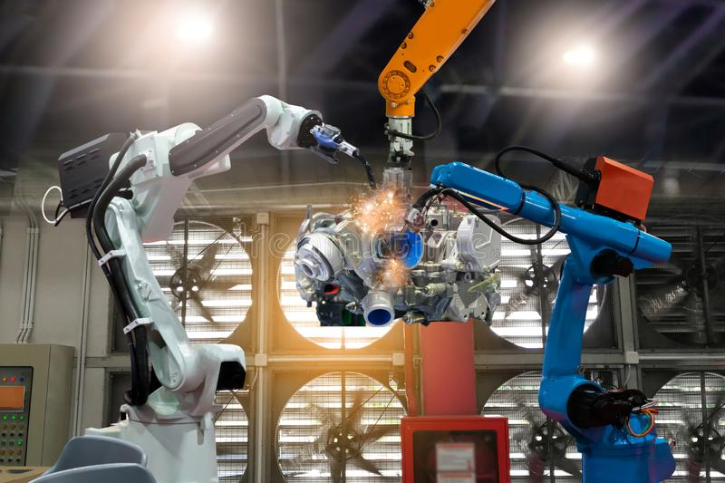 Control automation robot arms the production of factory parts engine manufacturing industry robots and mechanical royalty free stock image