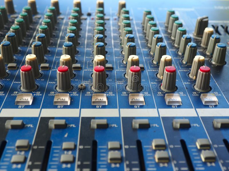 Control music buttons are on sound mixer. In the studio stock photography