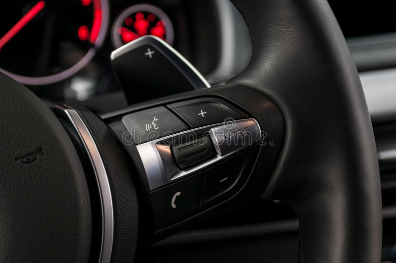 Control buttons on steering wheel. Modern car interior detail stock images