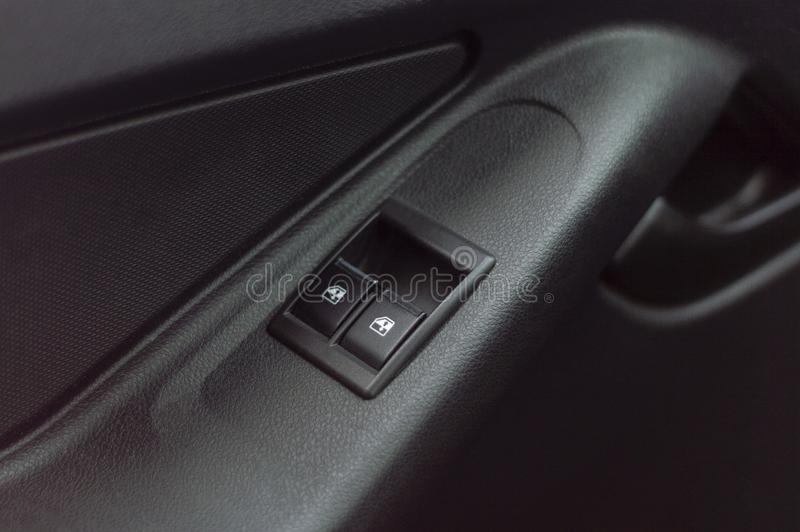 Control buttons windows in the car. View from above stock images